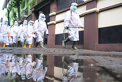March 16, 2020, Jakarta, Indonesia: Indonesian Red Cross officers when spraying disinfectants at  Middle School, Salemba, Jakarta. Today all school activities in a number of regions in Indonesia were closed to anticipate the spread of the coronavirus. (Credit Image: © Dasril Roszandi/NurPhoto via ZUMA Press)