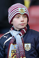Young Burnley fan looks on before k/o. The Emirates FA cup, 4th round match, Arsenal v Burnley at the Emirates Stadium in London on Saturday 30th January 2016.<br /> pic by John Patrick Fletcher, Andrew Orchard sports photography.