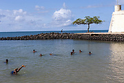 Boys swim and play in the sea next to the Fort Sao Sebastiao, Sao Tome <br /> Sao Tome and Principe, are two islands of volcanic origin lying off the coast of Africa. Settled by Portuguese convicts in the late 1400s and later a centre for slaving, their independence movement culminated in a peaceful transition to self government from Portugal in 1975.