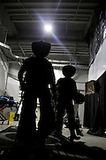 Bull riders walk down a tunnel before a Professional Bull Riders, Built Ford Tough Series event at the Sprint Center, Saturday, Feb. 11, 2017, in Kansas City, Mo. (AP Photo/Colin E. Braley)