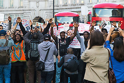 London, July 8th 2016. Hundreds gather on London's Southbank before marching through the streets of London to Parliament Square, Downing Street and the BBC, in a Black Lives Matter protest in solidarity with Americans following the shooting dead of two black men, Philando Castile in Minnesota and Alton Sterling in Louisiana by police in the US. PICTURED: The crowd marches up Regent Street towards the BBC.