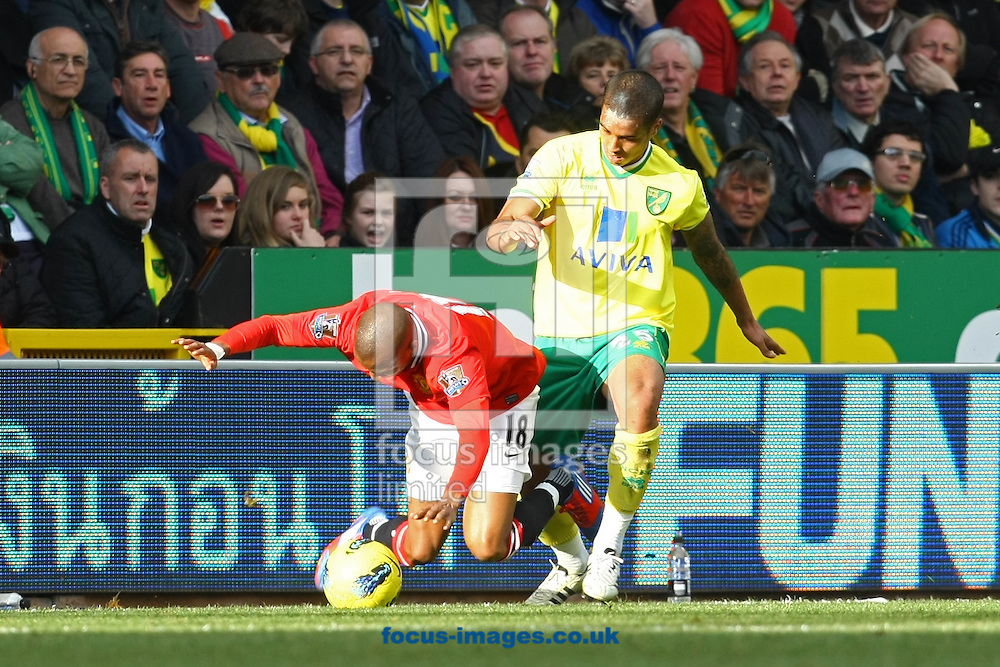 Picture by Paul Chesterton/Focus Images Ltd.  07904 640267.26/02/12.Kyle Naughton of Norwich and Ashley Young of Man Utd in action during the Barclays Premier League match at Carrow Road Stadium, Norwich.