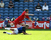 Photo: Paul Greenwood.<br />Stockport County v Cardiff City. Coca Cola Championship. Pre Season Friendly. 28/07/2007.<br />Stockports Keith Briggs, sends Cardiff's Steve Maclean flying