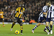 Yannick Sagbo of Hull city in action. Barclays Premier league, West Bromwich Albion v Hull city at the Hawthorns in West Bromwich, England on Saturday 21st Dec 2013. pic by Andrew Orchard, Andrew Orchard sports photography.