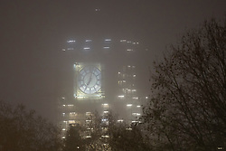 © Licensed to London News Pictures. 30/11/2020. London, UK. Fog shrouds Elizabeth Tower during a foggy morning in Westminster . Parts of the UK are experiencing heavy fog and low temperatures. Photo credit: George Cracknell Wright/LNP