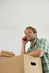Man telephone call listening moving new home