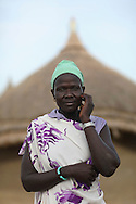 """Adhuom Achiek Buol, 32, Manydeng Village, Jonglei State, South Sudan. Farmer<br /> <br /> """"Farming will stop hunger. We the people of Jonglei were created to farm. It is in our culture. It is what we were born to do.""""<br /> <br /> The Catholic Relief Services (CRS) led Jonglei Food Security Program, JFSP, in Jonglei, South Sudan aims to address the root causes of hunger in Jonglei State while teaching people new skills that will help them fight hunger and provide for themselves. Roads, dykes, and water retention ponds have been built by JFSP participants, assets that will help the communities access market, mitigate flood risks, and provide watering holes for livestock during the dry season. Generously funded by the American people through USAID, the JFSP is a three-year program that will run through 2014."""