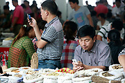Traders wait for customers at a traditional Chinese medicine market in Bozhou, Anhui Province, China on 02 August, 2011. The birth place of legendary doctor Hua Tuo, Bozhou is now one of the four major trading centers in China for traditional Chinese medicine.