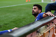 Diego Costa of Chelsea slips into the advertising boards. Premier league match, Stoke City v Chelsea at the Bet365 Stadium in Stoke on Trent, Staffs on Saturday 18th March 2017.<br /> pic by Andrew Orchard, Andrew Orchard sports photography.