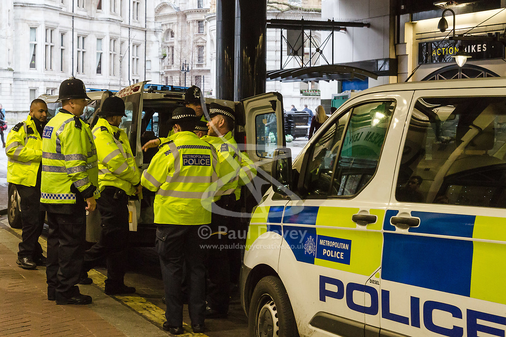 London, December 31 2017. Police in high visibility jackets and numerous anti-terrorism and crowd control measures are in place in the capital ahead of the New Year's Eve fireworks and revelry in central London. PICTURED: Police officers are given their instructions as they deploy at Embankment station. © SWNS