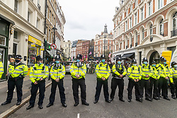 """Licensed to London News Pictures. 23/08/202. London, UK. A heavy police presence in Westminster as climate change protesters, Extinction Rebellion (XR), block St Martin's Lane in Covent Garden, London at the start of a 14 day protest with disruptive action and possible occupations of buildings and services. The protest, """"The Impossible Rebellion"""", want the government to implement their demand to stop all new fossil fuel investment immediately. Photo credit: Alex Lentati/LNP"""