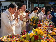"04 SEPTEMBER 2015 - BANGKOK, THAILAND: VEERA ROJPOJANARAT, the Minister of Culture for Thailand, (left) prays at the Erawan Shrine Friday. A ""Holy Religious Ceremony for Wellness and Prosperity of our Nation and Thai People"" was held Friday morning at Erawan Shrine. The ceremony was to regain confidence of the Thai people and foreign visitors, to preserve Thai religious customs and traditions and to promote peace and happiness inThailand. Repairs to Erawan Shrine were completed Thursday, Sept 3 after the shrine was bombed on August 17. Twenty people were killed in the bombing and more than 100 injured. The statue of the Four Faced Brahma in the shrine was damaged by shrapnel and a building at the shrine was damaged by debris.     PHOTO BY JACK KURTZ"