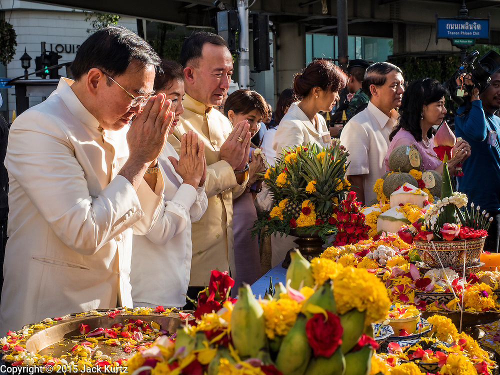 """04 SEPTEMBER 2015 - BANGKOK, THAILAND: VEERA ROJPOJANARAT, the Minister of Culture for Thailand, (left) prays at the Erawan Shrine Friday. A """"Holy Religious Ceremony for Wellness and Prosperity of our Nation and Thai People"""" was held Friday morning at Erawan Shrine. The ceremony was to regain confidence of the Thai people and foreign visitors, to preserve Thai religious customs and traditions and to promote peace and happiness inThailand. Repairs to Erawan Shrine were completed Thursday, Sept 3 after the shrine was bombed on August 17. Twenty people were killed in the bombing and more than 100 injured. The statue of the Four Faced Brahma in the shrine was damaged by shrapnel and a building at the shrine was damaged by debris.     PHOTO BY JACK KURTZ"""