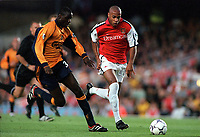 Thierry Henry (Arsenal) Djimi Traore (Liverpool) Arsenal 2:0 Liverpool, F.A.Carling Premiership, 21/8/2000. Credit : Colorsport / Andrew Cowie.