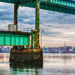 Portsmouth, New Hampshire waterfront as seen from under the Sarah Mildred Long Bridge in Kittery, Maine. HDR