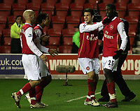 Photo: Paul Thomas.<br /> Wigan Athletic v Arsenal. The Barclays Premiership. 13/12/2006.<br /> <br /> Emmanuel Adebayor (R) is congratulated after celebrating in front of the Arsenal fans by his team-mates.