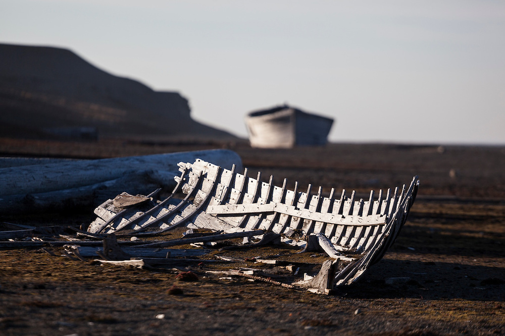 Remains of wood barges on the beach at Calypsobyen, Svalbard, site of a coal mining operation erected by the British Northern Exploration Company in the early 1900s.