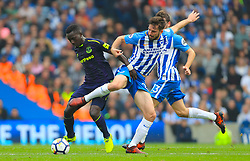 Everton's Idrissa Gueye (left) and Brighton & Hove Albion's Davy Propper battle for the ball during the Premier League match at the AMEX Stadium, Brighton.