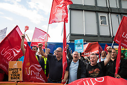 London, UK. 6th August, 2021. Steve Turner (c), candidate to become General Secretary of Unite, joins Unite members protesting outside the Euston construction site for the HS2 high-speed rail link regarding trade union access to construction workers building tunnel sections for the project. Unite claims that HS2's joint venture contractor SCS, formed by Skanska, Costain and Strabag, has been hindering 'meaningful' trade union access to HS2 construction workers in contravention of the HS2 agreement.
