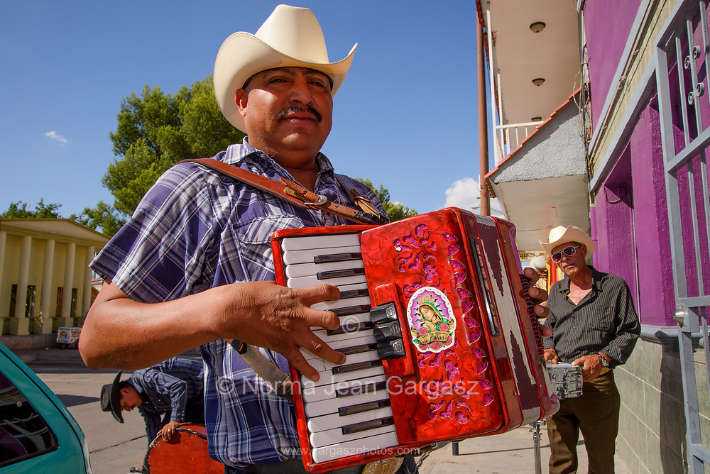 Musicians of Los Hermanos Moroyoqui play on the street in Nogales, Sonora, Mexico.