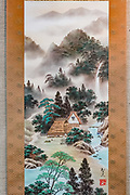 """""""Shan Shui with The Four Symbols"""" Japanese landscape hand-painting of Gassho-zukuri farmhouses with river, waterfall and forest, by Tomohisa Miyazaki (born in Gifu in 1955), on Washi Japanese paper, mounted on silk & polyester. Kyoto Museum of Traditional Crafts (or Fureaikan), in the Miyako Messe building, Sakyo Ward, Kyoto, Japan."""