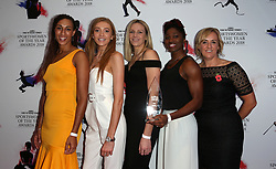 Team Of The Year (Left to right) England netball squad Geva Mentor, Helen Housby, Joanne Harten, Ama Agbeze and coach Tracey Neville pose with the trophy during The 2018 Sunday Times Sportswomen of the Year Awards Ceremony at The News Building, London.