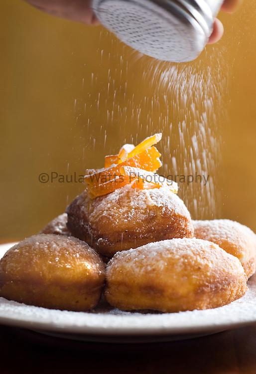 French beignet dessert with powdered sugar sprinkling