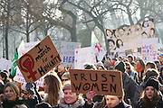 """January, 21st, 2017 - Paris, Ile-de-France, France:  Women protesters carry """"I march for humanity' and 'Trust Women' placards. Thousands of protesters in Paris join anti-Trump Women's March around the world."""