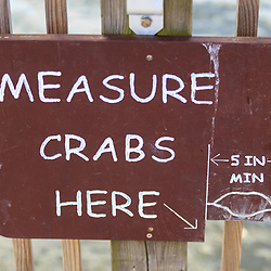 A measure crabs here sign in the Assateague Island National Seashore.