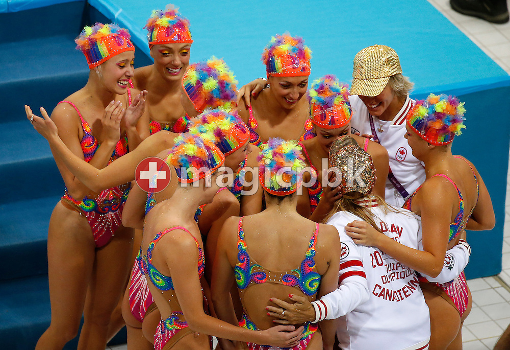 Members of team Canada celebrate with their coaches Anastassia Goutseva and Julie Sauve after competing in the Teams Free Routine Final during the Synchronized (Synchronised) Swimming competition held at the Aquatics Center during the London 2012 Olympic Games in London, Great Britain, Friday, Aug. 10, 2012. (Photo by Patrick B. Kraemer / MAGICPBK)