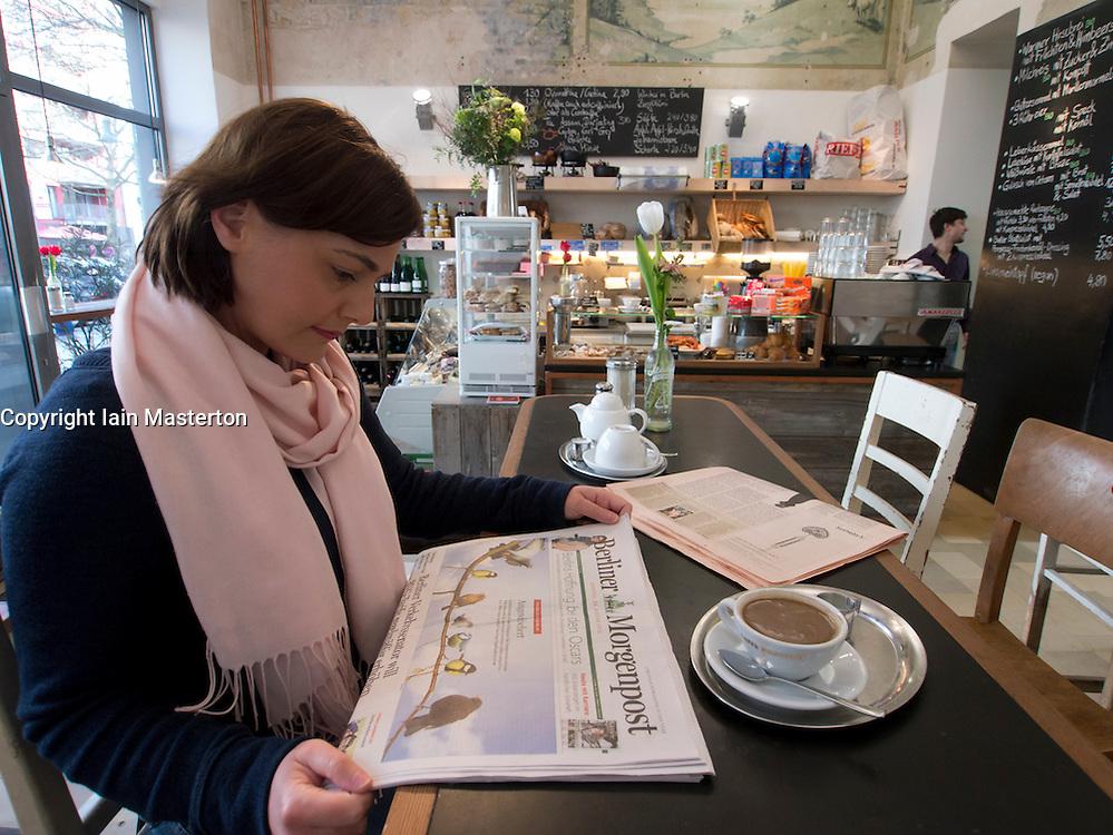 Breakfast inside  trendy bohemian cafe Meierei in Prenzlauer Berg Berlin Germany