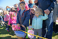North Merrick, New York, USA. March 31, 2018. Young girls and boys eagerly wait behind yellow tape for start of traditional Easter Egg Hunt at the Annual Eggstravaganza, held at Fraser Park and hosted by North and Central Merrick Civic Association (NCMCA).