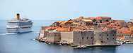 Stock photos of Dubrovnik Old town - View of the city walls and sea with a cruise liner .<br /> <br /> Visit our MEDIEVAL PHOTO COLLECTIONS for more   photos  to download or buy as prints https://funkystock.photoshelter.com/gallery-collection/Medieval-Middle-Ages-Historic-Places-Arcaeological-Sites-Pictures-Images-of/C0000B5ZA54_WD0s