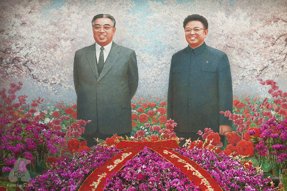 A large portrait of Kim Il Sung and Kim Jong Il - North Korea's late leaders - is displayed at the Kimilsungilia Flower Exhibition, in Pyongyang, North Korea.
