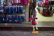A child sized mannequin is on display outside of a clothing store in Naples, Italy