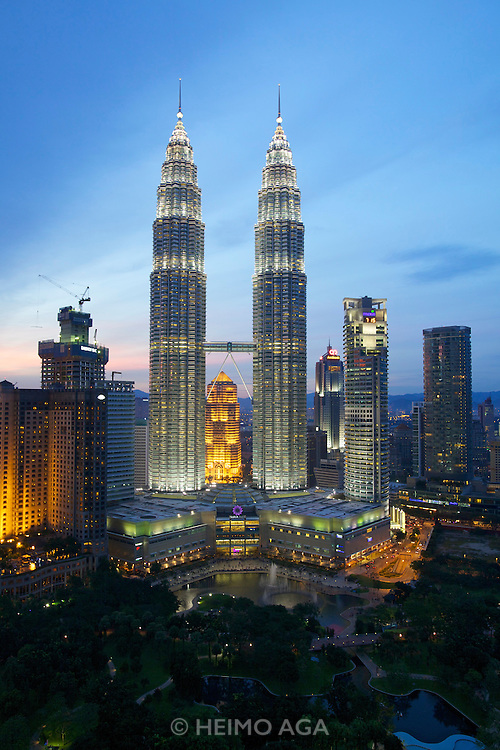 Malaysia, Kuala Lumpur. Dusk over Petronas Twin Towers, the tallest buildings on Earth from 1998-2004 (still the tallest twin buildings).