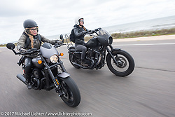 Iron Lilies Leticia Cline (L) on a new 2017 Harley-Davidson 750 Street Rod alongside Kristen Lassen on a 2014 Harley-Davidson Iron 883 Sportster as they ride AIA near Flagler Beach during Daytona Beach Bike Week. FL. USA. Tuesday, March 14, 2017. Photography ©2017 Michael Lichter.