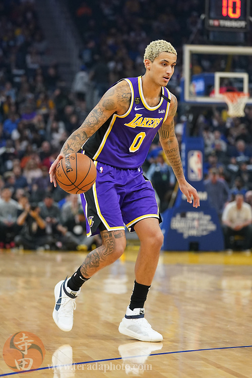 February 27, 2020; San Francisco, California, USA; Los Angeles Lakers forward Kyle Kuzma (0) dribbles the basketball against the Golden State Warriors during the second quarter at Chase Center.