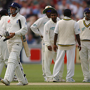 England's Mark Butcher leaves the pitch after being caught behind off the bowling of  Sri Lanka's Muttiah Muralitharan.