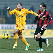 Genclerbirligi's Mehmet Seyfettin Sedef (R) and Galatasaray's Sercan Yildirim (L) during their Turkish Superleague soccer match Genclerbirligi between Galatasaray at the 19 Mayis stadium in Ankara Turkey on Saturday 03 December 2011. Photo by TURKPIX