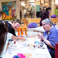 Linda Shelton, right, sells people raffle tickets for prizes at the 20th Relay For Life kickoff event at the Rio West Mall Saturday afternoon.