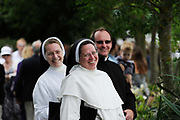 Nuns gather to watch rowing races at the Henley Royal Regatta, an annual event first held in 1839 in Henley-on-Thames, southern England. Off the water, competitors and spectators must adhere to the strict rules that have traditionally governed the dress and comportment of the British upper classes at play.