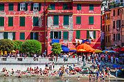 Tourists on the crowded beach at Vernazza, Cinque Terre, Liguria, Italy
