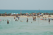 Israel, Haifa, People enjoying themselves at the beach. Spring May 2005