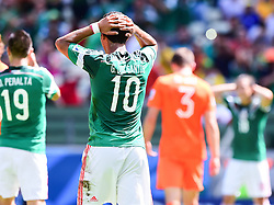 29.06.2014, Castelao, Fortaleza, BRA, FIFA WM, Niederlande vs Mexico, Achtelfinale, im Bild enttäuscht Giovani Dos Santos (Mexiko) // during last sixteen match between Netherlands and Mexico of the FIFA Worldcup Brazil 2014 at the Castelao in Fortaleza, Brazil on 2014/06/29. EXPA Pictures © 2014, PhotoCredit: EXPA/ fotogloria/ Best Photo Agency<br /> <br /> *****ATTENTION - for AUT, FRA, POL, SLO, CRO, SRB, BIH, MAZ only*****