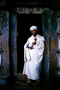 A Ethiopian priest at the cave monestery of Yimrehane Kristos near Lalibela, Ethiopia. Lalibela is one of Ethiopia's holiest cities, second only to Aksum, and is a center of pilgrimage for much of the country.