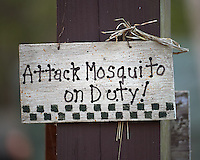 """""""Attack Mosquito on Duty"""" sign at Clyde Butchers Swamp Cottage. Big Cypress Swamp in Florida. Image taken with a Nikon Df camera and 70-200 mm f/4 VR lens (ISO 800, 200 mm, f/4, 1/200 sec)."""