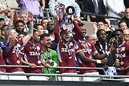 Aston Villa midfielder Conor Hourihane (14) holds the trophy during the EFL Sky Bet Championship play off final match between Aston Villa and Derby County at Wembley Stadium, London, England on 27 May 2019.