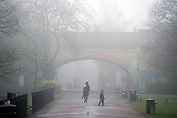 © Licensed to London News Pictures. 01/04/2014. Hammersmith, UK. A railway bridge shrouded in fog.  A foggy morning in Ravenscourt Park in Hammersmith West London today April 1st 2014. Photo credit : Stephen Simpson/LNP