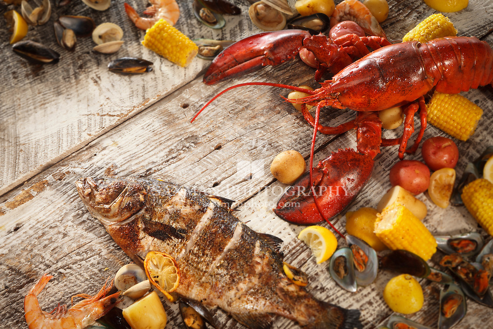 Seafood Boil concept, shot with distressed wood planks as table